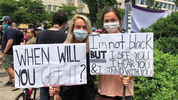 Sisters Sarina Lecroy, 20, and Grace Lecroy, 16, at a protest in Washington